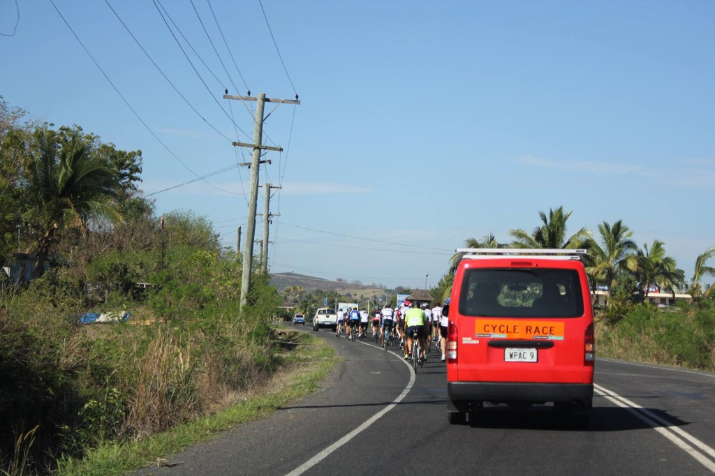 Rear of peleton heading out of Nadi early on Stage 1
